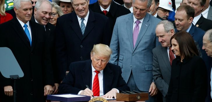 President Donald Trump signs USMCA trade pact and ends NAFTA