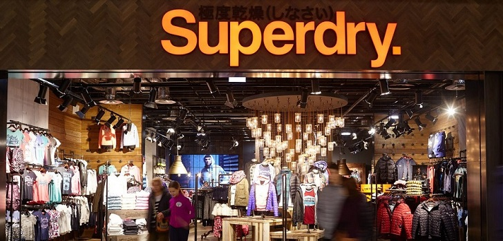 Superdry sales shrink by 11% in first half, losses widen